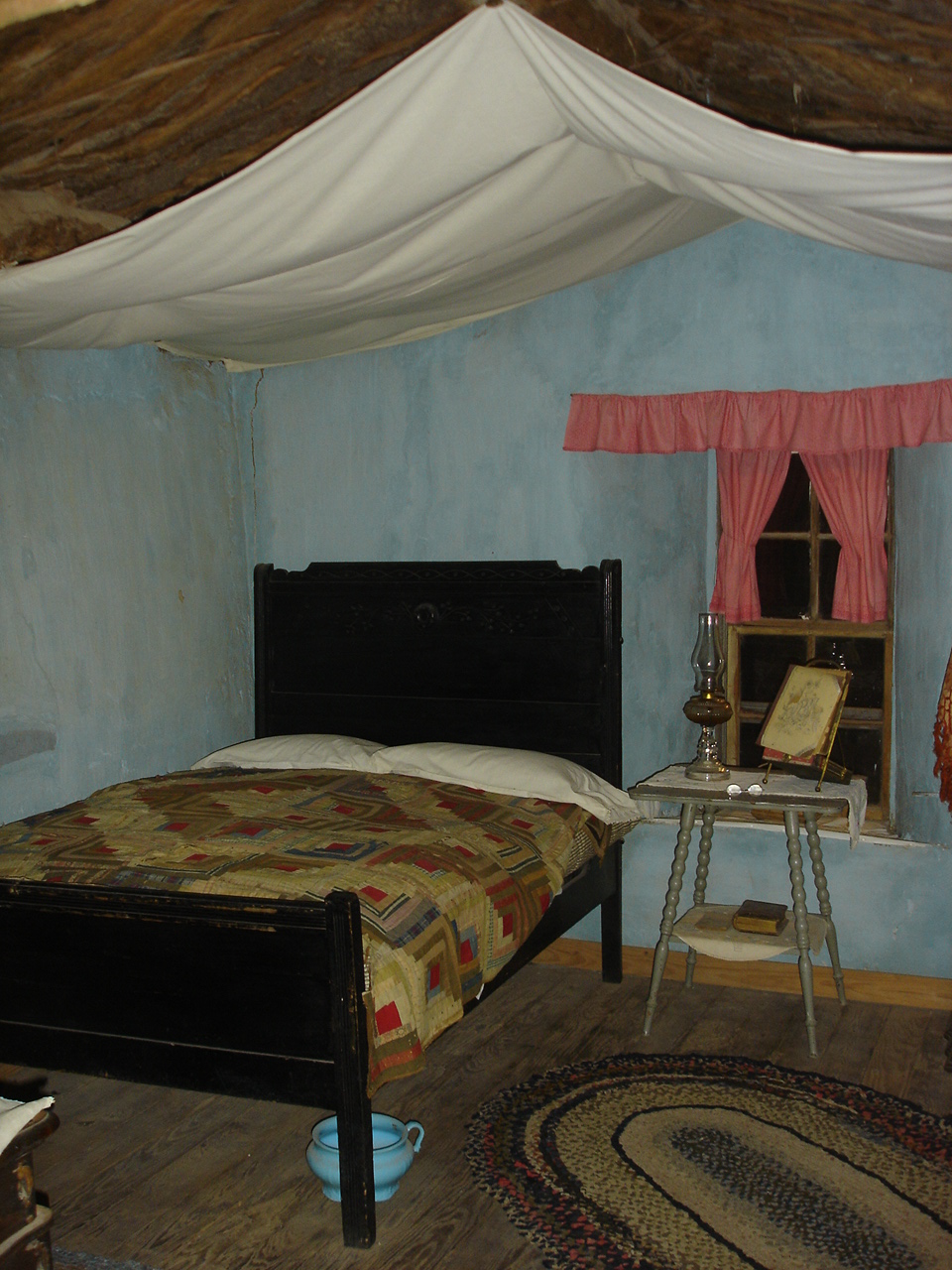 Sod House Bed With Log Cabin Quilt And Muslin Sheets