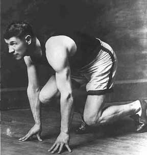 Jim Thorpe in position to sprint