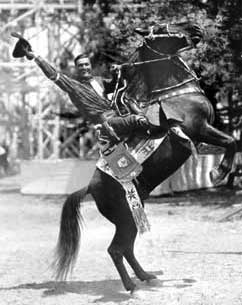 Tom Mix on the back of a horse